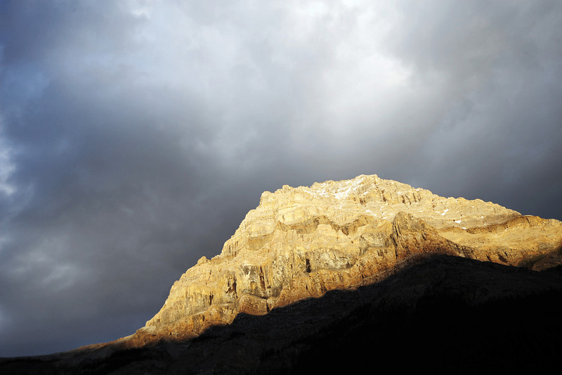 Sunrays on large rockface, Canadian Rockies