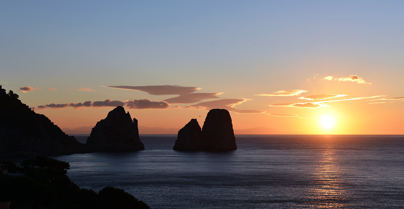 Winter sunrise over sea stacks (faraglioni) along Capri's southern shore, Italy