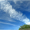 it pays to look up...<br /> <br /> Upon arriving home several days ago, my wife spotted this beautiful and unusual (possibly a vapor trail?) cloud formation. She said I should take a picture! <br /> <br /> Thanks for your comments!<br /> <br /> Critiques welcome...<br /> <br /> 21 June 2013