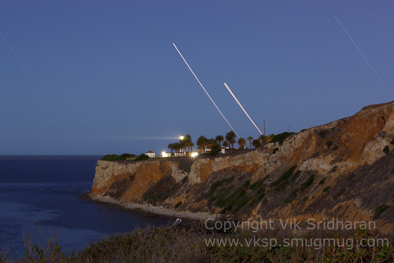 Venus (right) and Jupiter setting over Point Vicente Light.