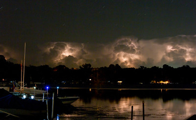A thunderstorm lights up the clouds over Forest lake