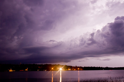A nighttime supercell thunderstorm with a large inflow band, over a northern MN lake in July 2014