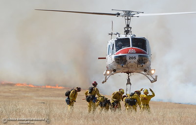 Firefighters along with the help of a CAL FIRE Helicopter battle a grass fire of approx. 150 acres along Skyway just outside of Chico, Calif. Friday June 16, 2017. (Bill Husa -- Enterprise-Record)