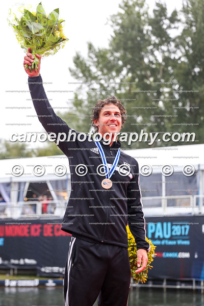 Mike Dawson (NZL) on the podium after winning bronze medal in the men's extreme kayak race at the ICF Canoe Slalom World Championships in Pau, France.