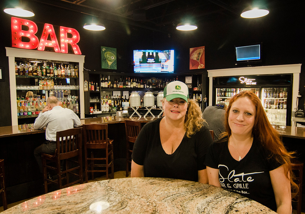 . The Luxury Box, located in Leominster, has recently changed ownership and become Slate Bar & Grille, as seen on Thursday, July 13, 2017. Pictured are co-owners Bethany Wayne and Nicole Cote, not pictured is third co-owner Carlos Melendez. SENTINEL & ENTERPRISE / Ashley Green