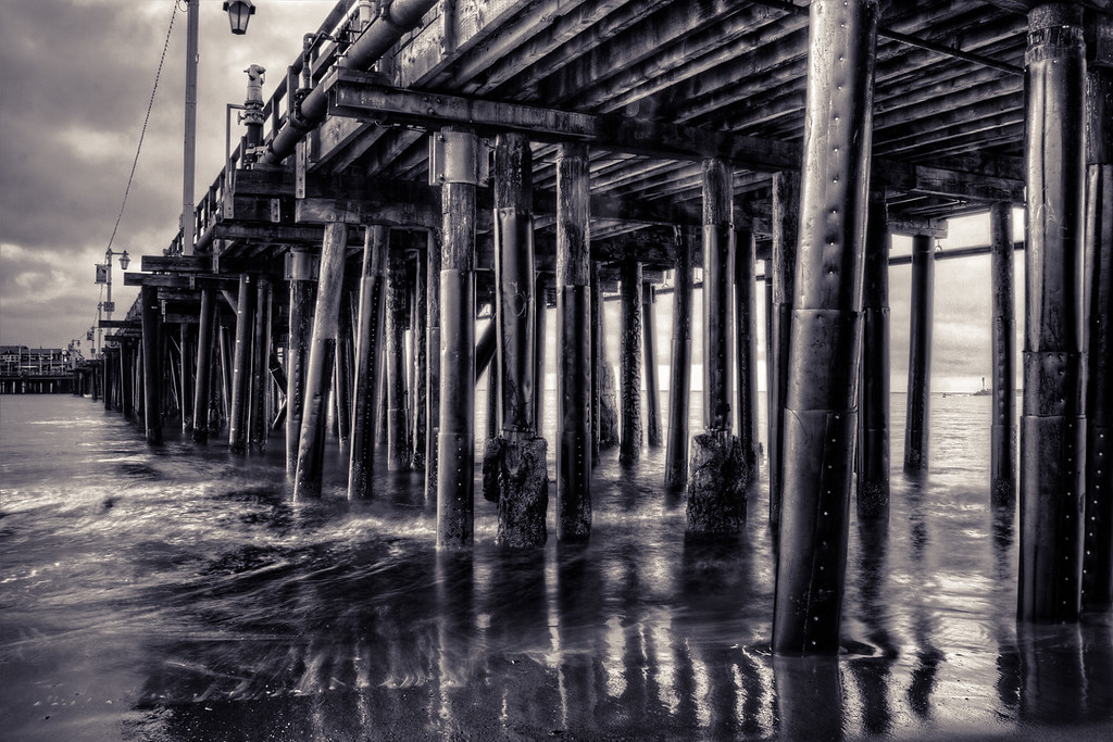 I've shot this pier in Santa Barbara quite a few times.  I'm lucky enough to get to travel there a couple of times each year and visit this spot each time I go.  Usually it's very California when I'm there - blue skies, pretty mountains inland and nice view out to sea.  This day as a little different.  It was wet and overcast and dark right at sunrise so I grabbed some shots of underneath the pier and tried to go along with the mood.  Ironically two hours after I shot this on the way to the office in Goleta, it was back to being the California coast again.