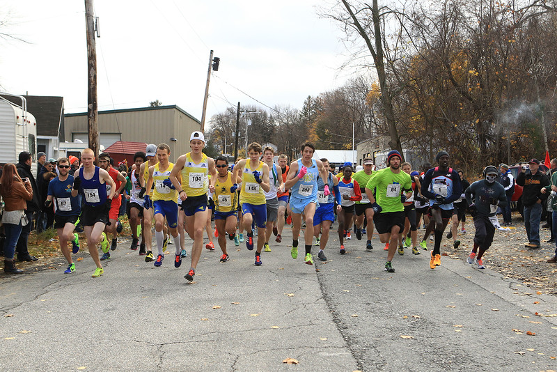 Runners leave the starting line during the Slattery's Turkey Trot race in Fitchburg on Sunday, Nov. 20, 2016. SENTINEL & ENTERPRISE / SCOTT LAPRADE