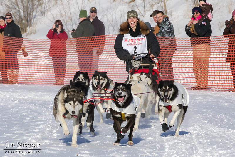 Jennifer Freking's 10-dog team near the start of the 2013 WolfTrack Classic