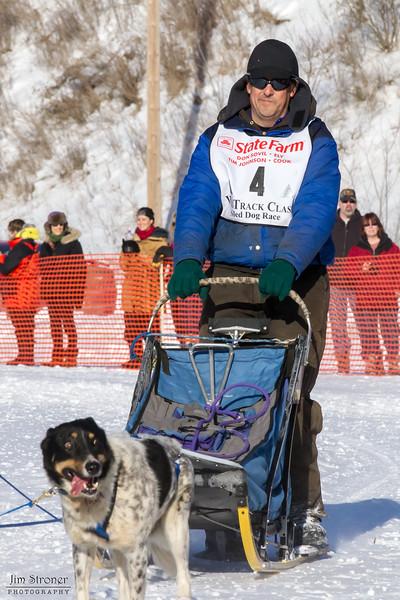 Steve Rasmussen's 10-dog team near the start of the 2013 WolfTrack Classic