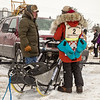 Amanda Vogel talking to fan before the 2014 John Beargrease Marathon race