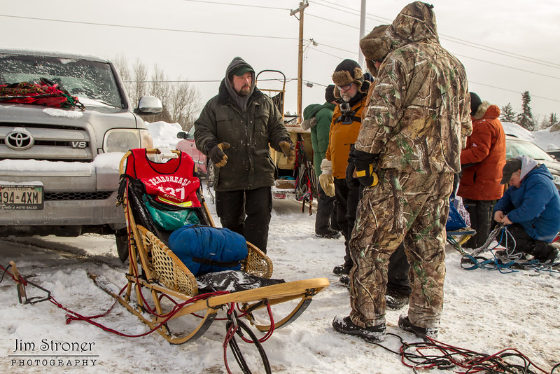 Brian Wiese talking to fans before the 2014 John Beargrease Mid-Distance race