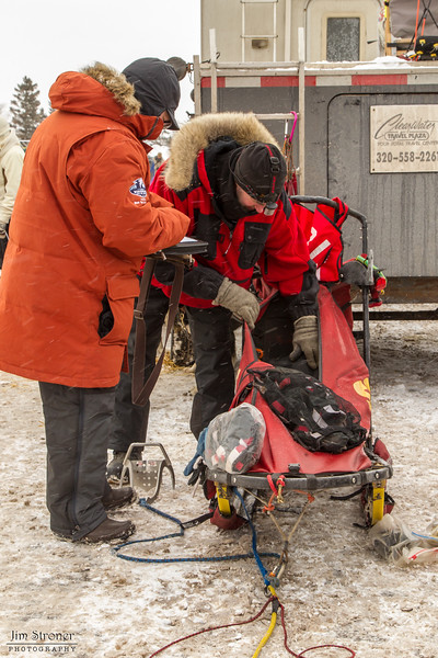 Michael Bestgen going through mandatory gear at the 2014 John Beargrease Mid-Distance race