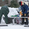 Replacing runners on Nathan Schroeder's sled at the Devil Track lake checkpoint during the 2014 John Beargrease Marathon race