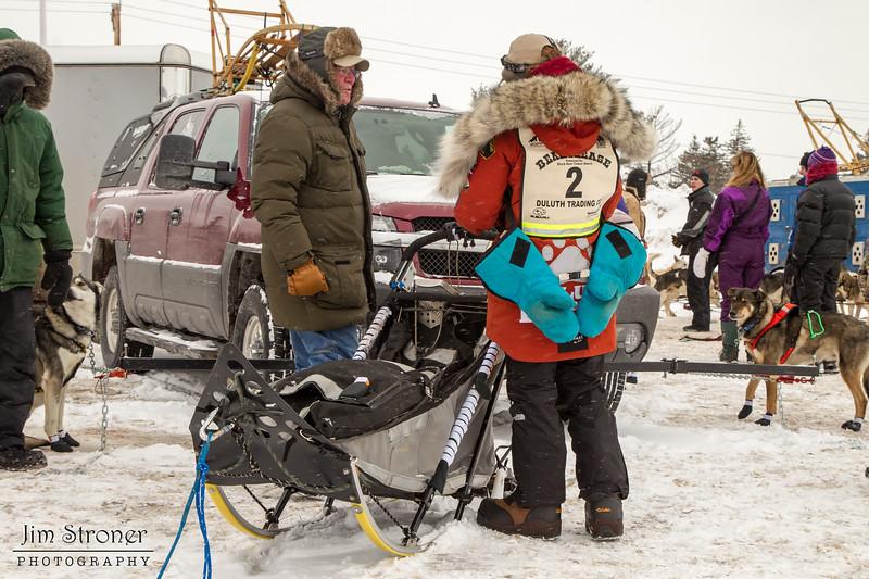 Amanda Vogel talking to fan before the 2014 John Beargrease Marathon race