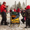 Peter McClelland's handler showing fans the required equipment carried in the sled during the 2014 John Beargrease Marathon