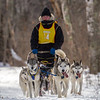 Alison Critchfield on the trail near Windy Lake during the Mid-Minnesota 150 sled dog race