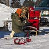 Bob Johnson preparing his sled at the start of the Mid-Minnesota 150 sled dog race