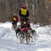 Kelly Sipper passing Jay Malchow on the trail near Windy Lake during the Mid-Minnesota 150 sled dog race