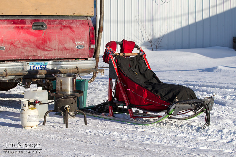 Linus Meyer preparing his sled at the start of the Mid-Minnesota 150 sled dog race