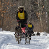 Nick Turman and Patty Salls on the trail near Windy Lake during the Mid-Minnesota 150 sled dog race