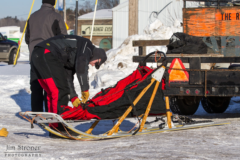 Saul Ellering preparing food for his team before the start of the Mid-Minnesota 150 sled dog race