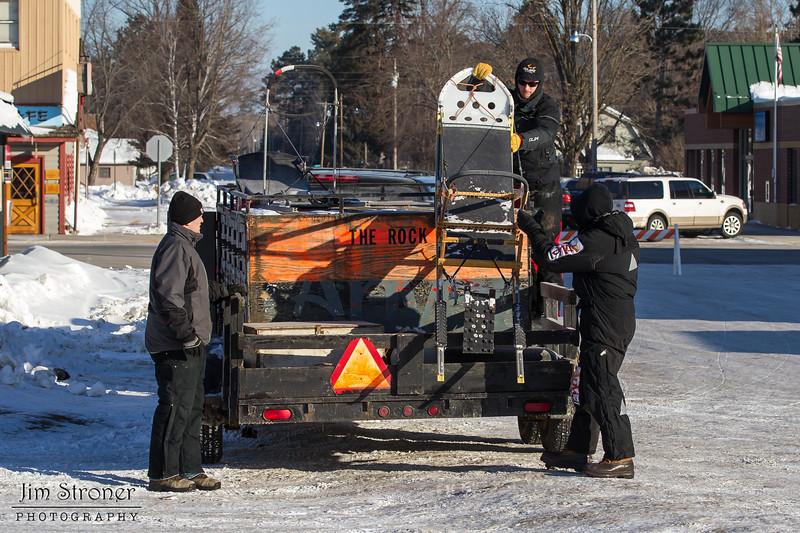 Saul Ellering preparing food for his team before the start of the Mid-Minnesota 150 sled dog race