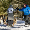 Theo Theobald greating Samuel Louters 8-dog team as they pass through Bear Head Lake during the 2015 WolfTrack Classic