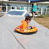 Kevin Fortier, 8, enjoys the sledding at Chelmsford Community Education Summerfest at Center Elementary School on Wednesday morning. SUN/JOHN LOVE