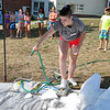 Sara Paul Migliozzi, 18, went down the plastic to held kids sled during the Chelmsford Community Education Summerfest at Center Elementary School on Wednesday morning. SUN/JOHN LOVE