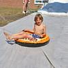 Matthew Monnes, 9, enjoys the sledding at Chelmsford Community Education Summerfest at Center Elementary School on Wednesday morning. SUN/JOHN LOVE