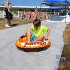 David Maillet, 8, enjoys the sledding at Chelmsford Community Education Summerfest at Center Elementary School on Wednesday morning. SUN/JOHN LOVE