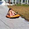 Margot Betton, 9, enjoys the sledding at Chelmsford Community Education Summerfest at Center Elementary School on Wednesday morning. SUN/JOHN LOVE