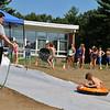 Kids wait in line to enjoy the sledding at Chelmsford Community Education Summerfest at Center Elementary School on Wednesday morning. SUN/JOHN LOVE
