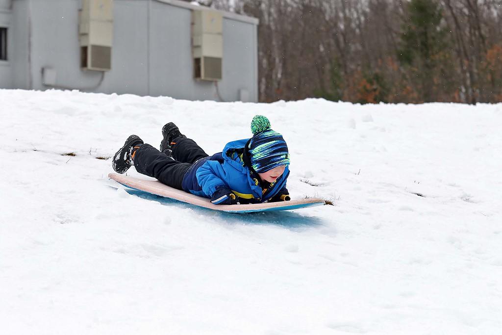 . Jason Ptak, 6, from Leominster enjoyed sledding down the hill next to Frances Drake Elementary School in Leominster on Saturday.  SENTINEL & ENTERPRISE/JOHN LOVE