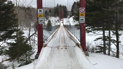 Johnny O' crossing a snowmobile bridge