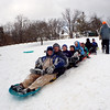 Jonathan Tressler - The News-Herald. An 11-person sled train prepares to take the plunge down the hill at Riverview Park in Madison Township Dec. 14.