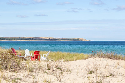 Beach chairs on Lake Michigan with Sleeping Bear Point in the background: Glen Arbor, Michigan