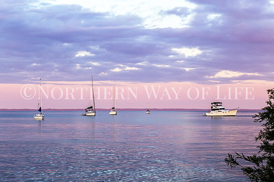 Sailboats at the end of a beautiful summer day: Northport, Michigan