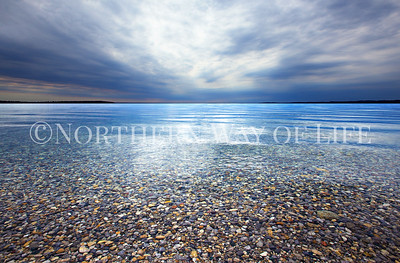 Northport Bay looking clear as glass with moody skies overhead