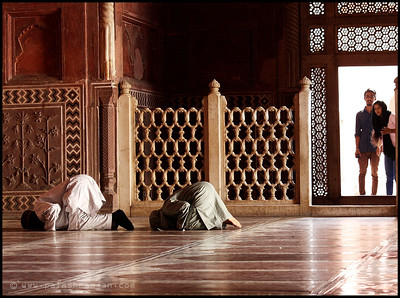 Couple offering prayers at the Mosque in the Taj Mahal Complex