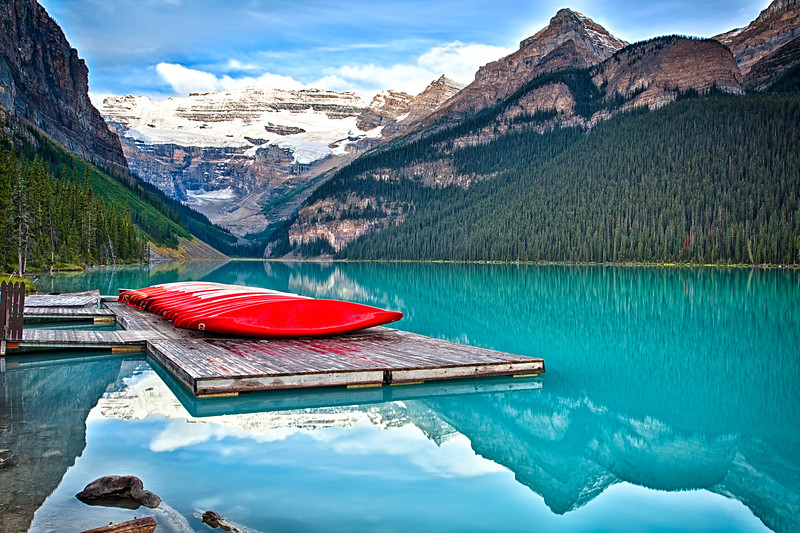 Red Canoes on a Wodden Dock, Lake Louise, Alberta Canada