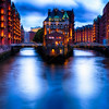 Water Castle on an Island Between Warehouse Buildings Illuminated at Night, Hamburg, Germany