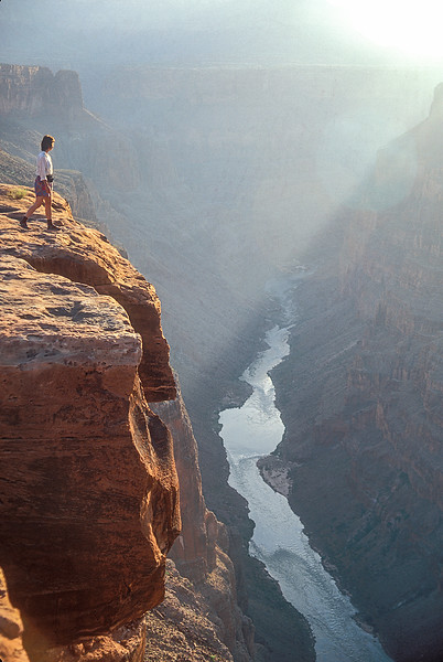 Model Released, Woman Hiker at Toroweap Overlook viewing Colorado River, Grand Canyon National Park, Arizona
