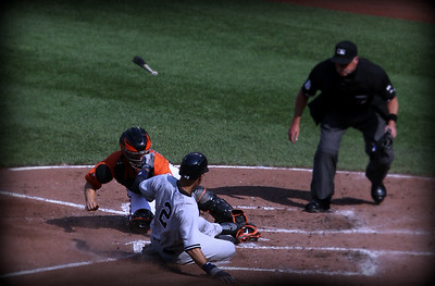 Derek Jeter a play at home plate....