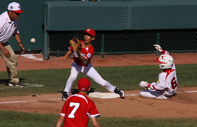 Little League World Series. 2011 Japan vs Canada. Japanees player safe on steal of third.