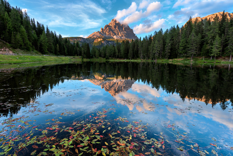 Reflections at lake Antorno in Dolomites