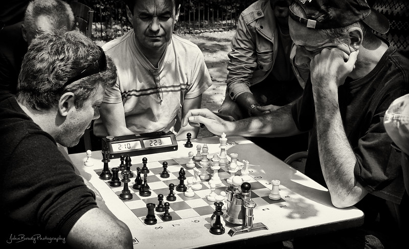 Intense game of chess at Luxemburg Gardens in Paris - Furrowed brows and dead silence -  - John Brody Photography / JohnBrodyPhotography.com / JohnBrody.com