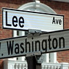 The city of Lexington's new street signs (Mattingly House, aka old Sigma Chi, behind).