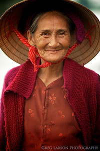 Lady in Red, market in Hoi An, Vietnam.