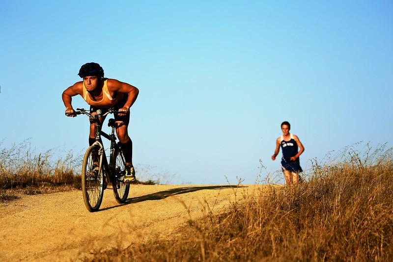 Lead runner following the lead biker, Sunnyvale Baylands